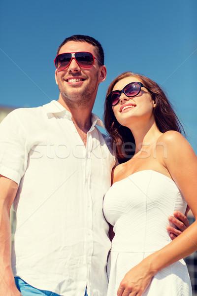 smiling couple in city Stock photo © dolgachov