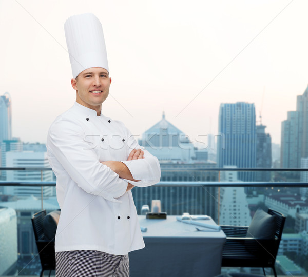 Heureux Homme chef Cook mains cuisson Photo stock © dolgachov