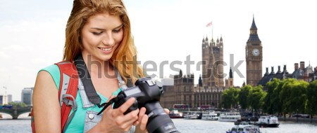 close up of happy lesbian couple over big ben Stock photo © dolgachov
