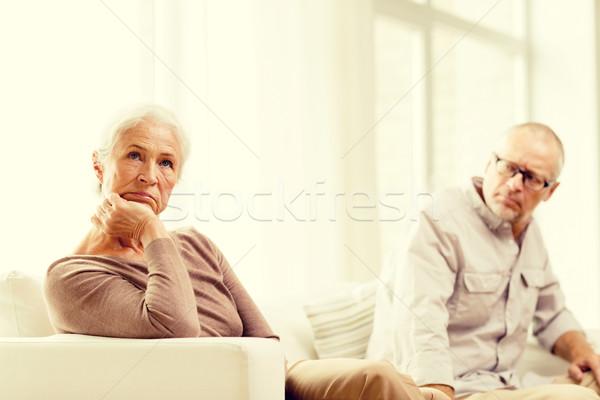 senior couple sitting on sofa at home Stock photo © dolgachov