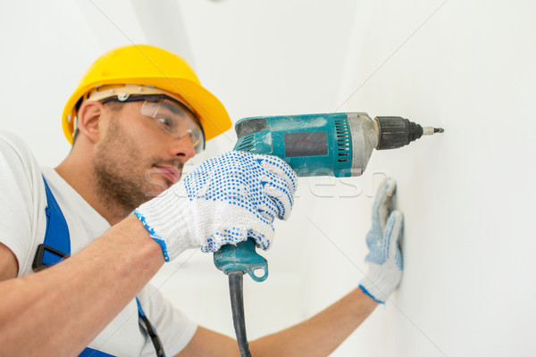 építész munkavédelmi sisak fúró fal épület dolgozik Stock fotó © dolgachov