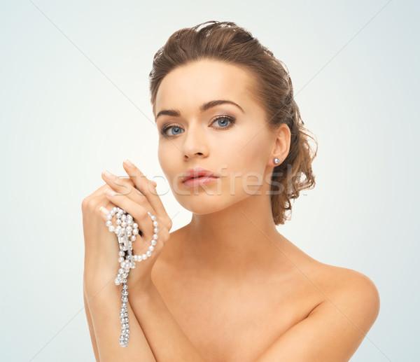 Mulher pérola brincos colar bela mulher Foto stock © dolgachov