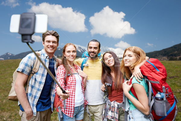 Stock photo: friends with backpack taking selfie by smartphone