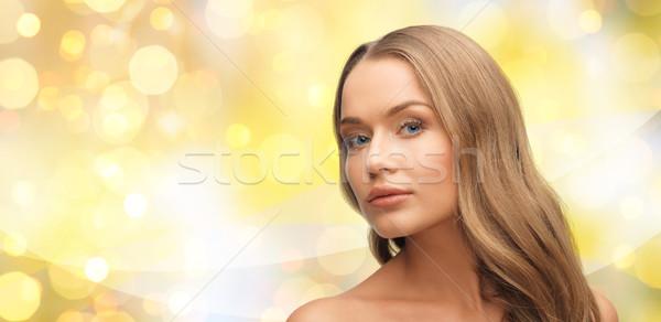 Mooie jonge vrouw gezicht Geel lichten schoonheid Stockfoto © dolgachov