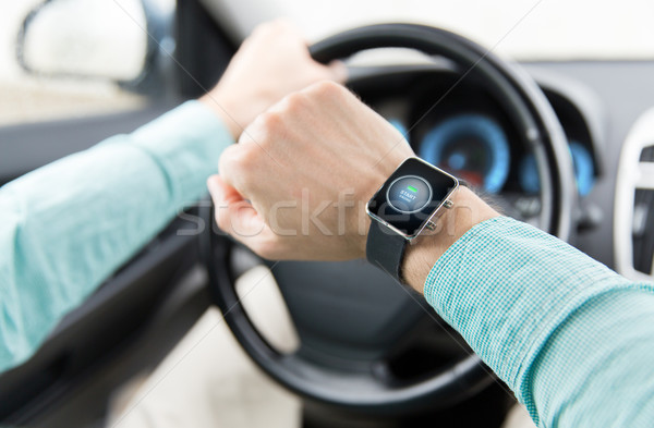 hands with starter icon on smartwatch driving car Stock photo © dolgachov
