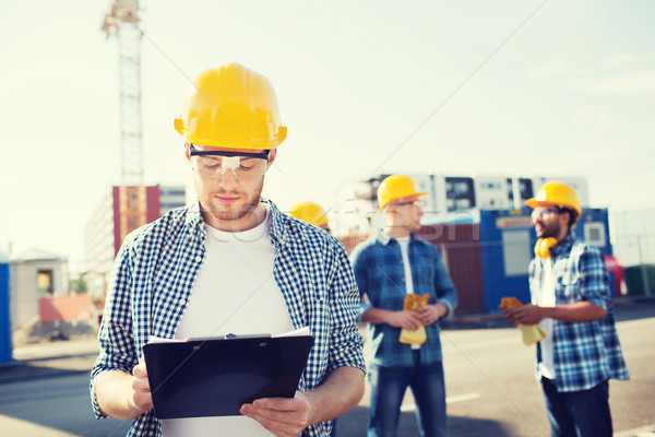 Grupo construtores ao ar livre negócio edifício trabalho em equipe Foto stock © dolgachov