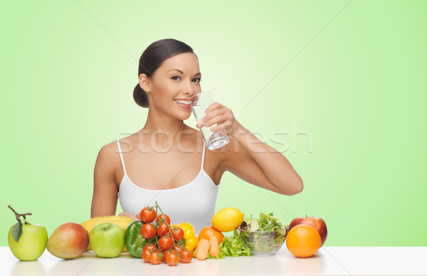 woman with fruits and vegetables drinking water Stock photo © dolgachov