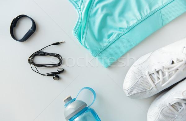 sportswear, bracelet, earphones and bottle set Stock photo © dolgachov