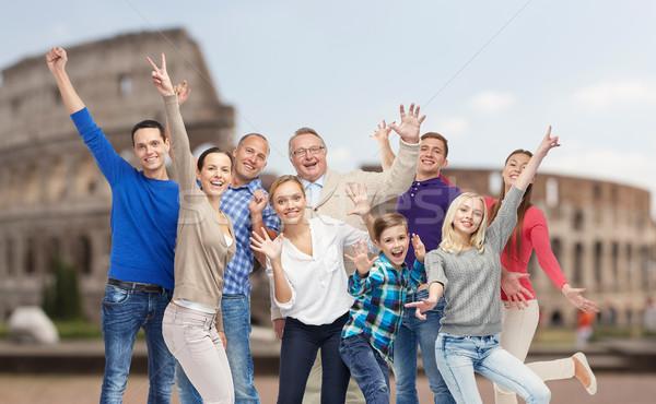 group of happy people having fun over coliseum Stock photo © dolgachov