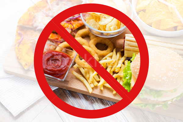 close up of fast food snacks behind no symbol Stock photo © dolgachov