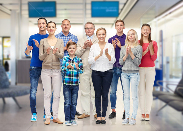 group of smiling people applauding Stock photo © dolgachov