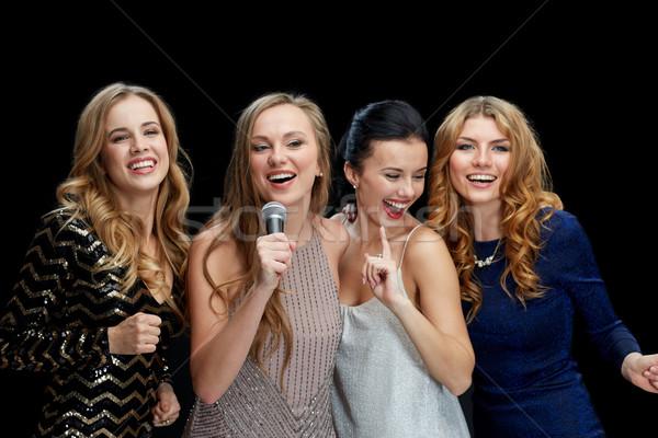 Mutlu mikrofon şarkı söyleme karaoke tatil Stok fotoğraf © dolgachov