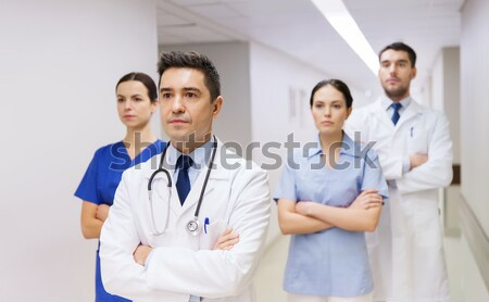 group of doctors at hospital pointing finger up Stock photo © dolgachov