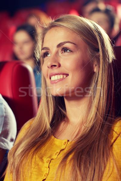 Boldog fiatal nő néz film színház mozi Stock fotó © dolgachov