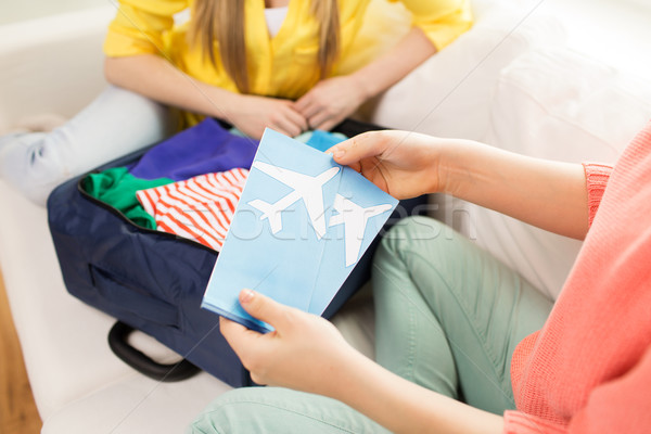 close up of women with tickets and travel bag Stock photo © dolgachov