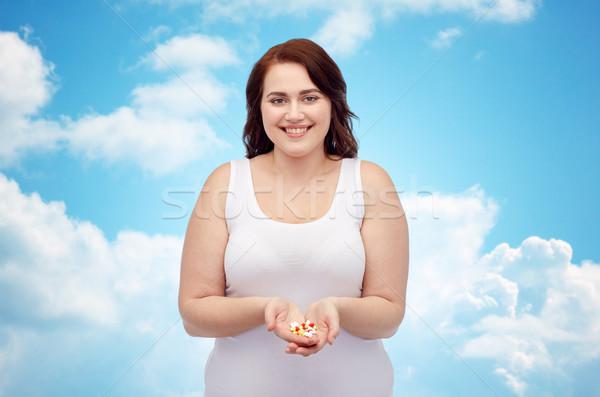 Szczęśliwy plus size kobieta bielizna pigułki Zdjęcia stock © dolgachov