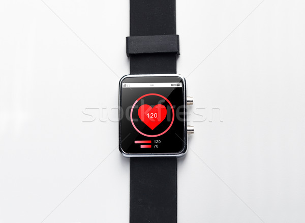 close up of smart watch with heart-rate on screen Stock photo © dolgachov