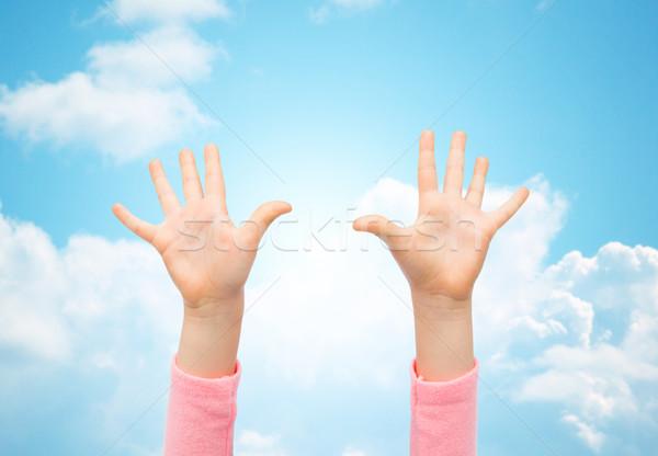 close up of little child hands raised upwards Stock photo © dolgachov