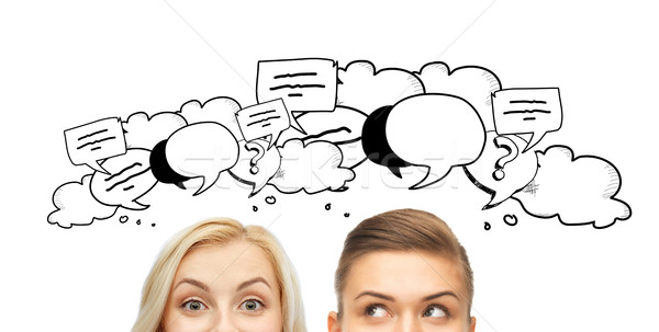happy young women faces with text clouds Stock photo © dolgachov