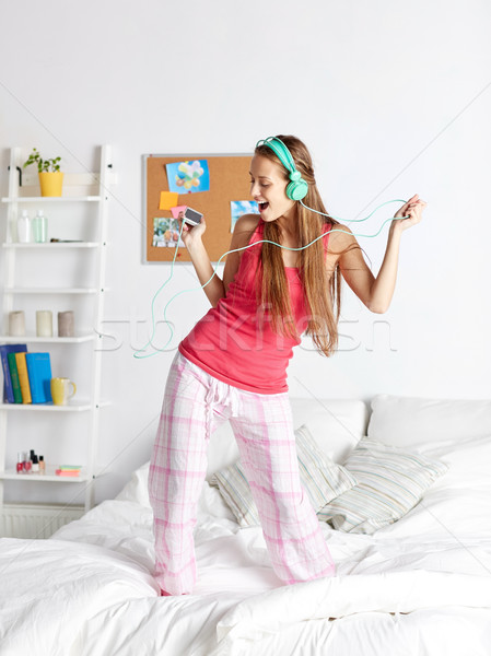 happy woman in headphones ihaving fun at home Stock photo © dolgachov