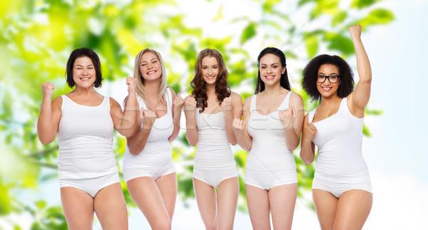 Groep gelukkig verschillend vrouwen vieren overwinning Stockfoto © dolgachov