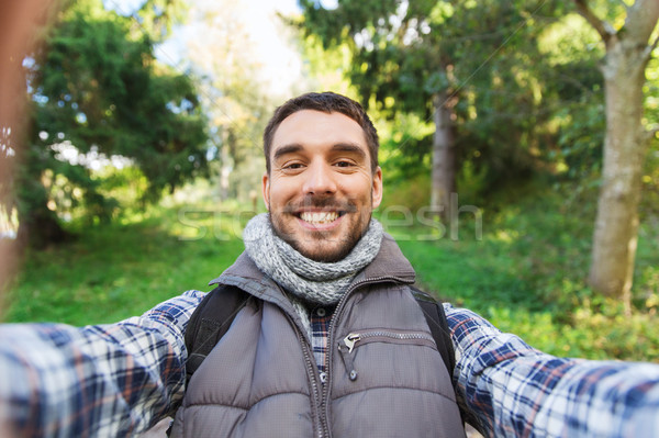 happy man with backpack taking selfie and hiking Stock photo © dolgachov