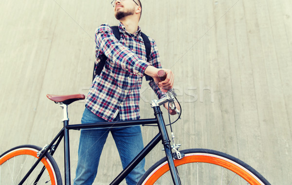 Adam sabit dişli bisiklet sırt çantası Stok fotoğraf © dolgachov