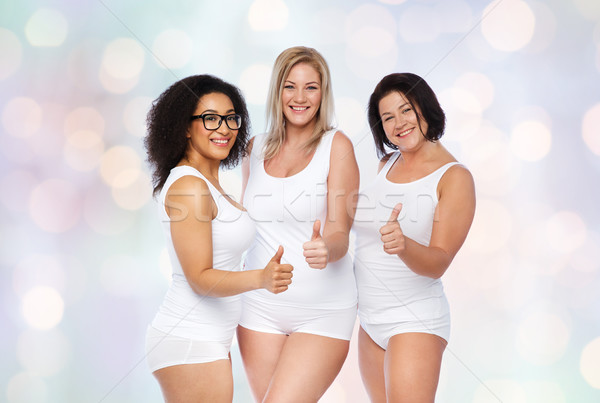 Stock photo: group of happy plus size women showing thumbs up