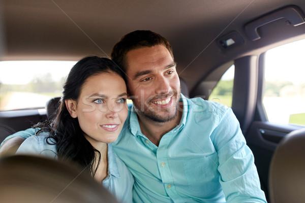 happy man and woman hugging in car Stock photo © dolgachov