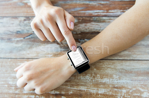 close up of hands with coding on smart watch Stock photo © dolgachov