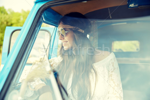 smiling young hippie woman in minivan car Stock photo © dolgachov