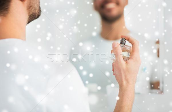 close up of man perfuming with perfume at bathroom Stock photo © dolgachov