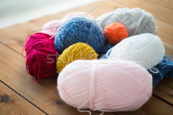 knitting needles and balls of yarn on wood Stock photo © dolgachov