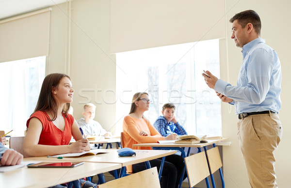 students and teacher with tablet pc at school Stock photo © dolgachov
