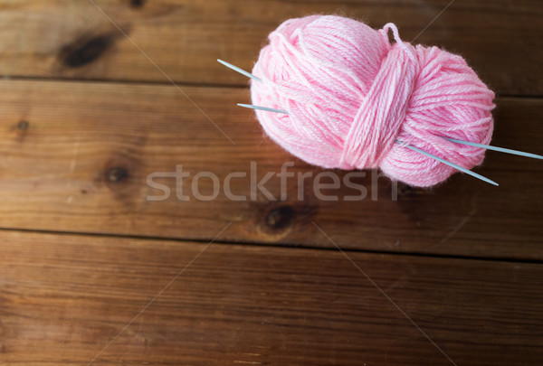 knitting needles and ball of pink yarn on wood Stock photo © dolgachov