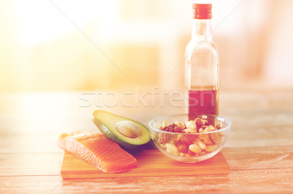 close up of food and olive oil bottle on table Stock photo © dolgachov