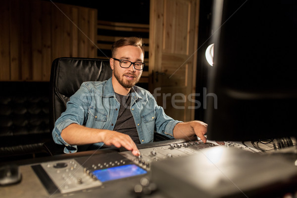 man at mixing console in music recording studio Stock photo © dolgachov