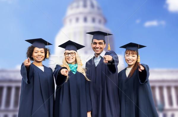 Boldog diákok agglegények mutat ujj oktatás Stock fotó © dolgachov