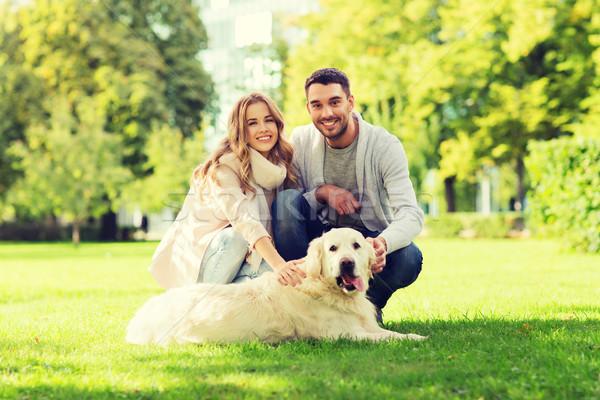 happy couple with labrador dog walking in city Stock photo © dolgachov