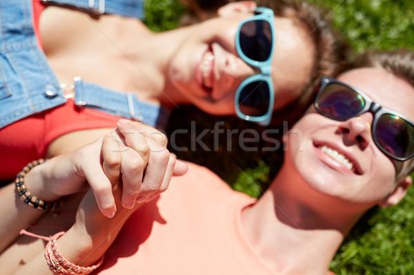 Boldog tini pár fű nyár szeretet Stock fotó © dolgachov
