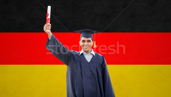 happy male student with diploma  over german flag Stock photo © dolgachov