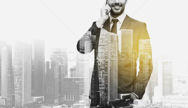 Sorridere imprenditore chiamando smartphone business tecnologia Foto d'archivio © dolgachov