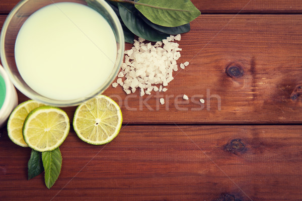 close up of citrus body lotion in bowl on wood Stock photo © dolgachov
