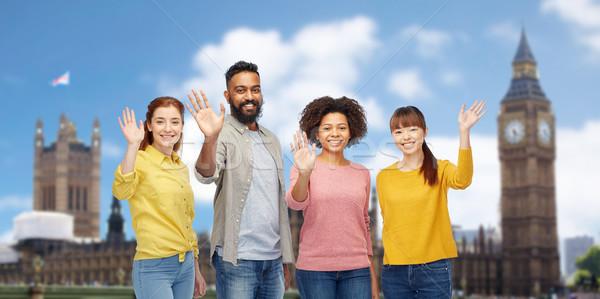 international group of happy people waving hands Stock photo © dolgachov
