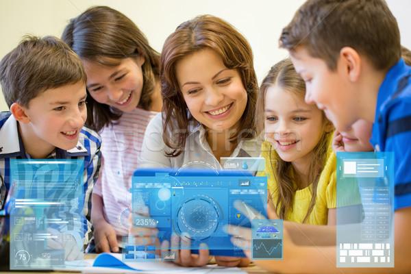 Stock fotó: Csoport · gyerekek · tanár · táblagép · iskola · oktatás