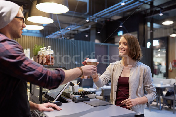 seller giving coffee cup to woman customer at cafe Stock photo © dolgachov