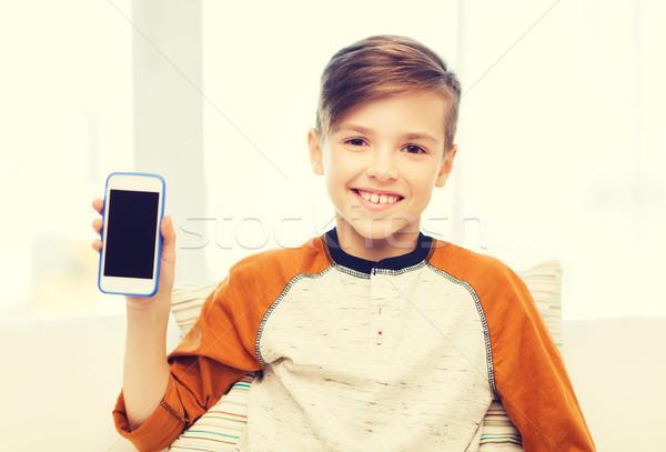 улыбаясь мальчика смартфон домой отдыха детей Сток-фото © dolgachov