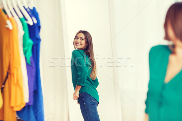 happy woman posing at mirror in home wardrobe Stock photo © dolgachov