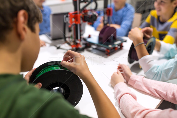 children with 3d printer at robotics school Stock photo © dolgachov