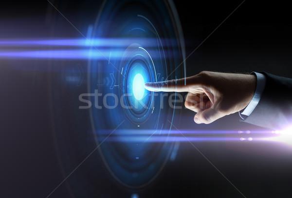 Masculina mano senalando dedo virtual proyección Foto stock © dolgachov
